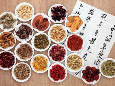 27837522 - chinese herbal medicine selection with calligraphy script describing the medicinal functions to maintain body and spirit health and balance body energy